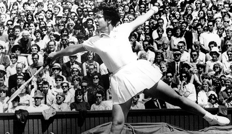 Billie Jean King playing tennis.