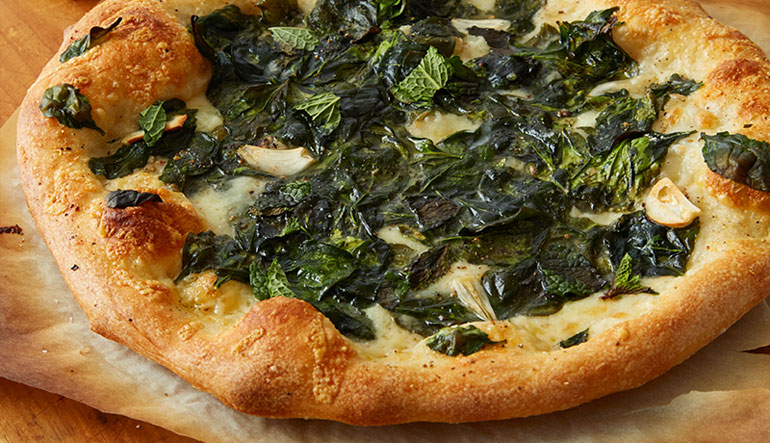 Spinach and cheese pizza.