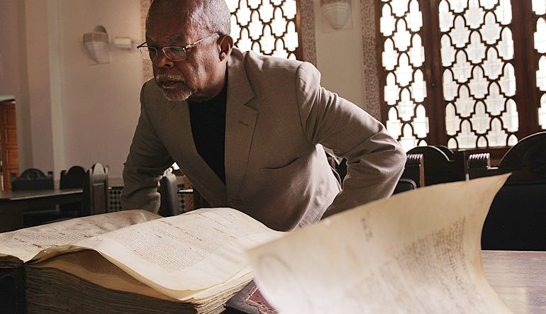 Immersed in an old manuscript, Henry Louis Gates, Jr. reads at the world's oldest working library, Al-Karaouine Library in Fes, Morocco.