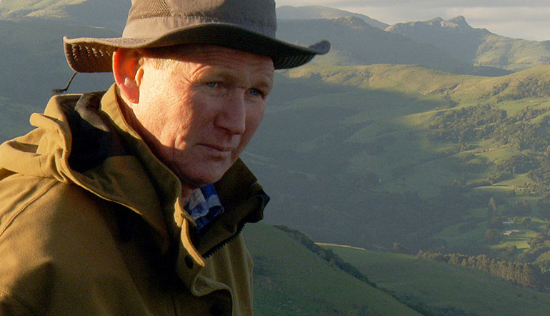 Roger Beattie looks over the New Zealand countryside.