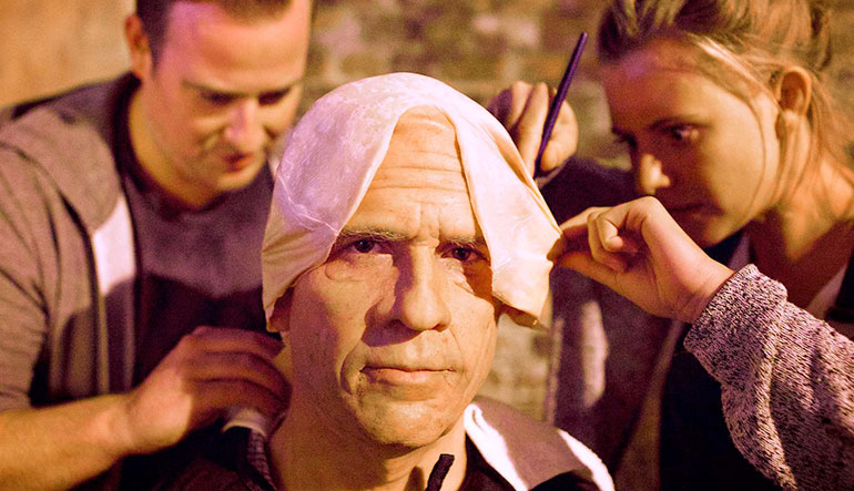 Man undergoing extensive aging makeup.