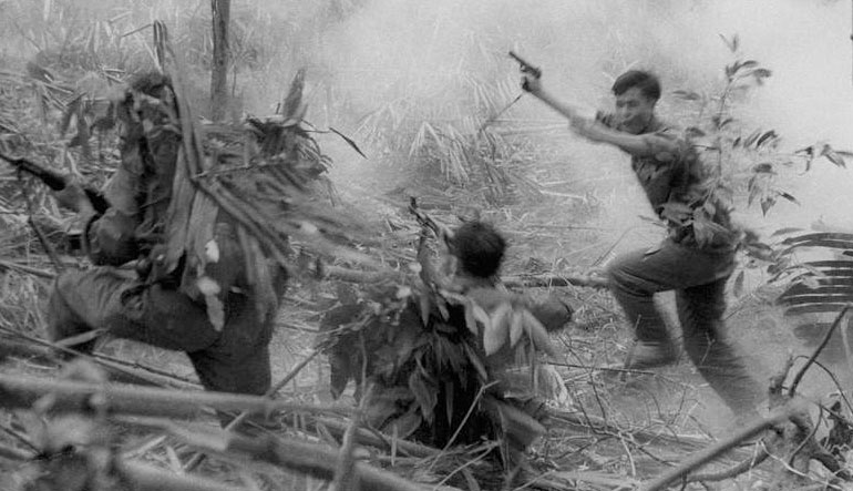 North Vietnamese Army officer leads an attack on South Vietnamese forces. Laos 1971.