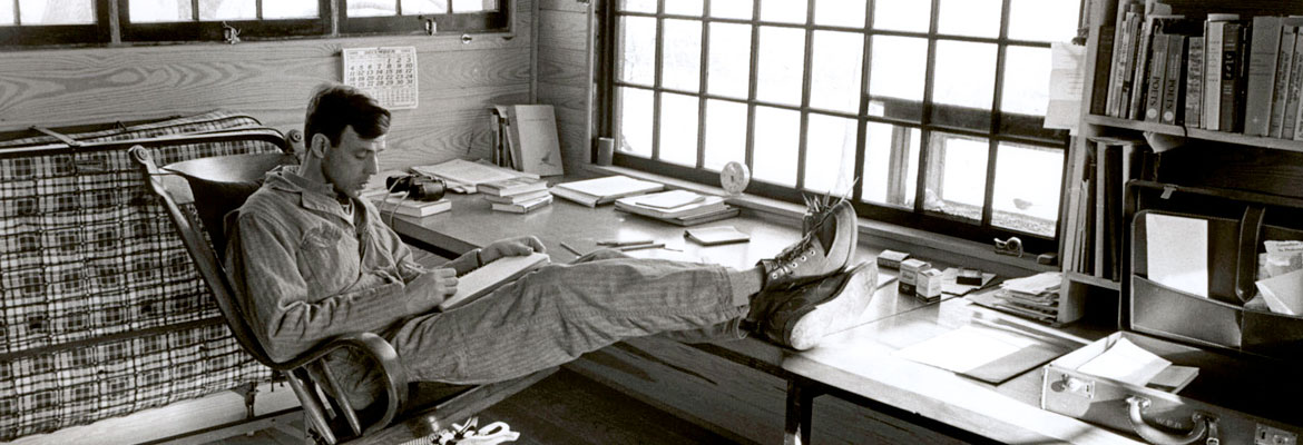 Wendell Berry writes at his forty-paned window, 1970s.