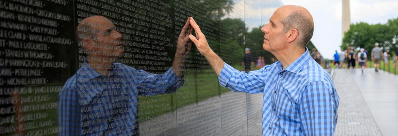Geoffrey Baer at the Vietnam Veterans Memorial in Washington, DC.