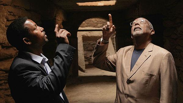 Henry Louis Gates, Jr. and Assistant Professor Abebaw Gela marvel from the tunnels below the stelae field in Axum, Ethiopia.