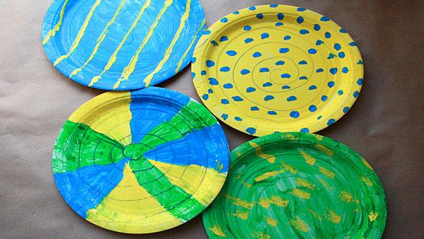 Paper Plates decorated as snakes.