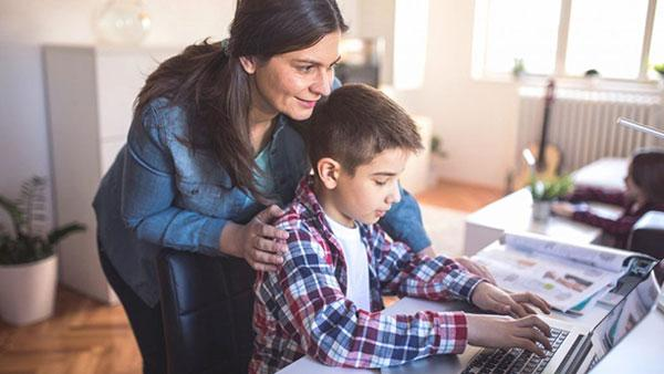 Mother and son on computer