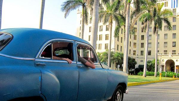 Old car and Havana hotel