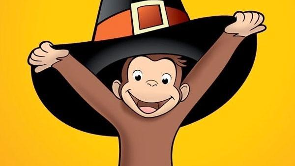 Curious George under a pilgrim hat.