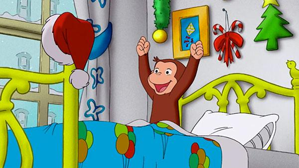Curious George on Christmas morning.