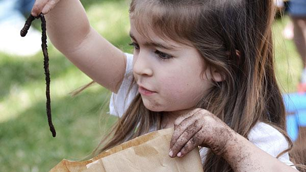 Little girl with worm.