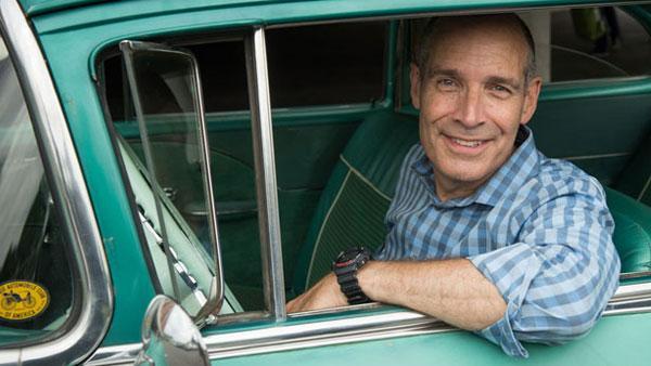 Geoffrey Baer in an old car
