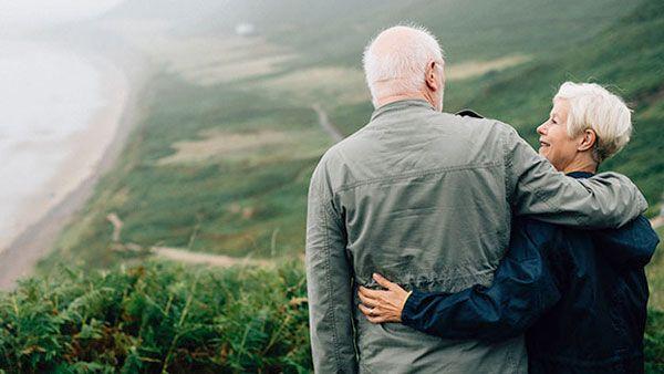 An older couple overlooking the coastline.