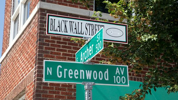 Street signs along Greenwood that commemorate Black Wall Street are just one part of local residents' recent efforts to remember their past. Photo by Beau Brand