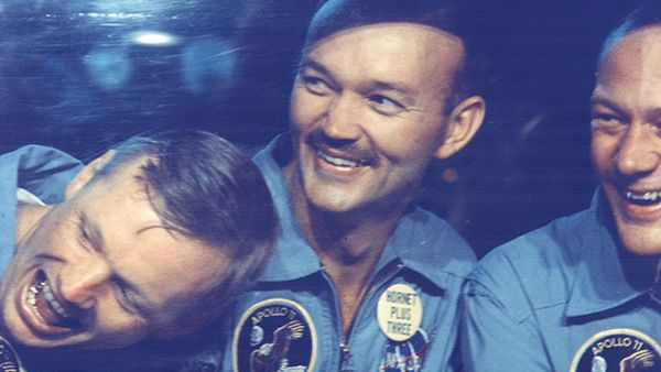 Apollo 11 astronauts, left to right, Neil Armstrong, Michael Collins and Edwin E. Aldrin, Jr., share jokes with well-wishers on the other side of the window of their Mobile Quarantine Facility aboard the USS Hornet. July 24, 1969.