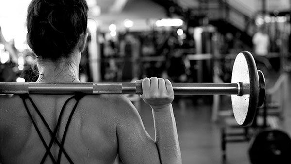 Woman lifting weight.
