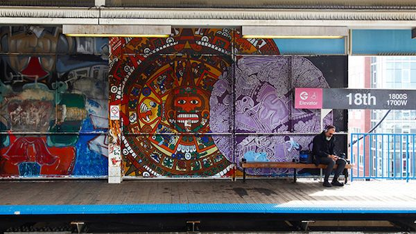 A commuter waits on the train on the 18th Street Pink Line platform. Photo by Kaitlynn Scannell