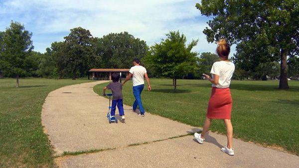 family walking through a park (WTTW News)