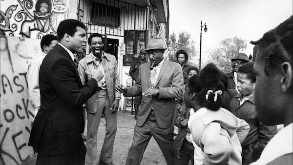 Muhammad Ali enjoying a spontaneous encounter with his fans in Detroit, MI. Circa 1977. Photo: Courtesy Michael Gaffney