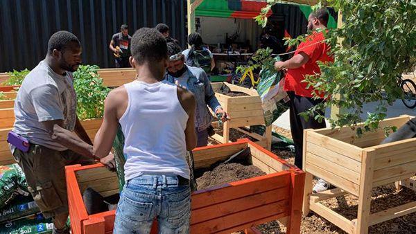 Men working in a community garden