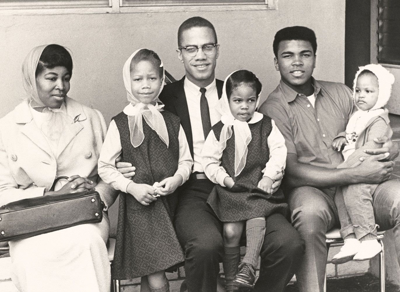 Malcolm X and family with Cassius Clay
