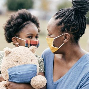 Girls and mom in masks.