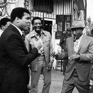 Muhammad Ali enjoying a spontaneous encounter with his fans in Detroit, MI. Circa 1977.