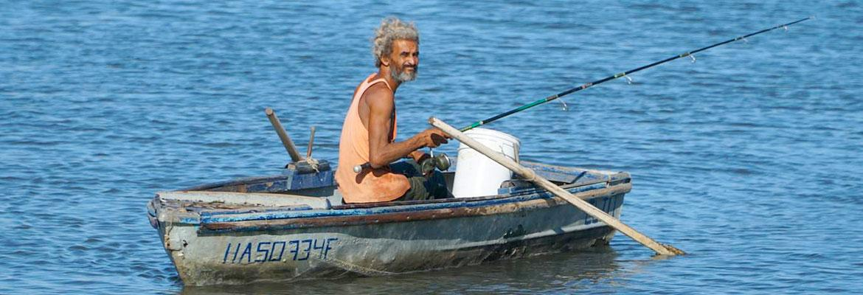 A cuban fisherman in his rowboat.