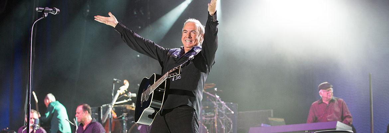 Neil Diamond performing.